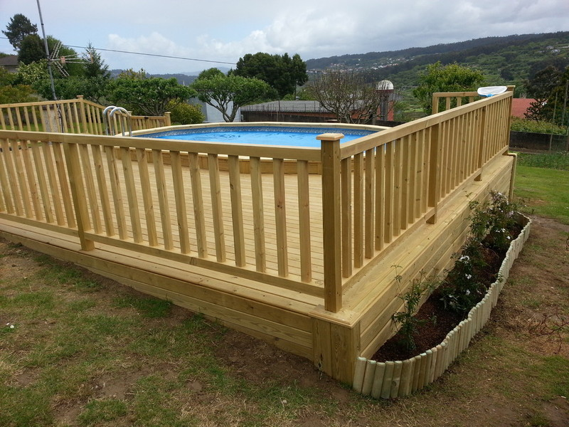 Valla de madera tratada barroteada for Vallas de hierro para jardin